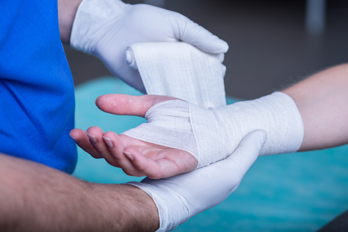 doctor bandaging hand and wrist